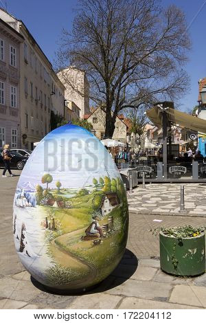 ZAGREB/CROATIA-APRIL 21: Old Tkalciceva street in Zagreb on April 21 2015 in Croatia. In the foreground a lot of egg painted with images of famous Croatian Naive Art.