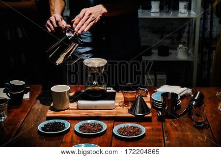 Hand drip coffee Barista pouring water over the coffee powder