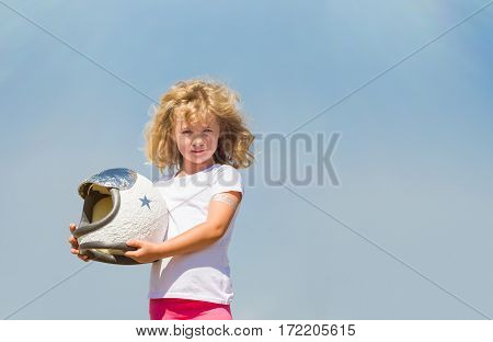 Portrait of blonde little girl in an astronaut costume dreaming of becoming a spacemen.