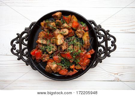 Tasty Meat With Vegetable On Frying Pan On White Wood Background