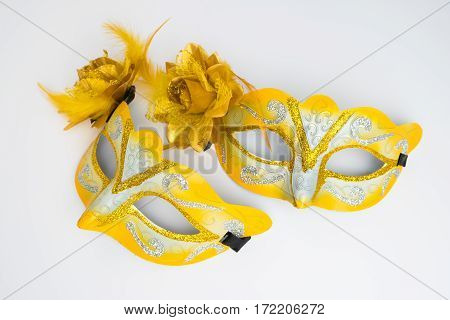 Colorful carnival mask on white background. Top view