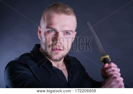 Man In Black Shirt With Katana Traditional Sword. With Copy Space