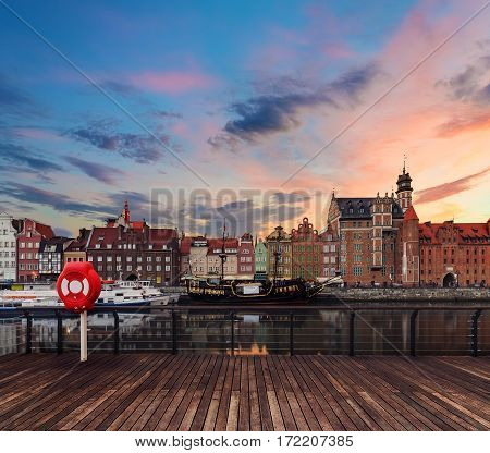 Background with wooden floors and Gdansk cityscape during sunset. Poland Europe.