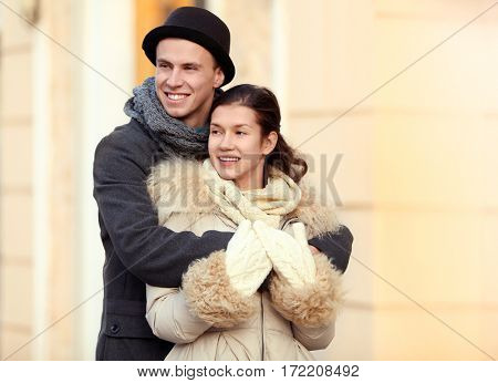 Young couple embracing on the street