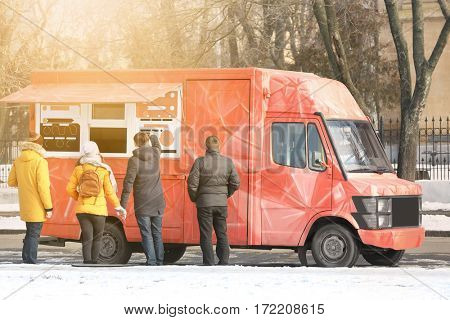 People near fast food truck on city street