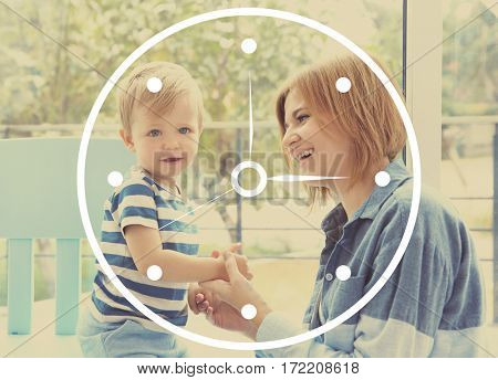 Time concept. Mother playing with child at home