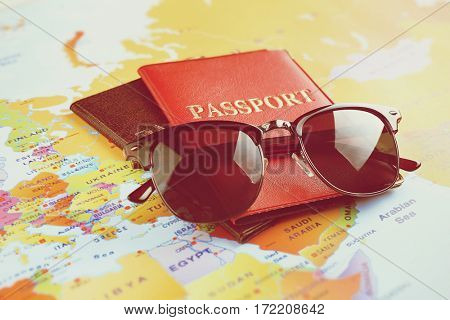 Travel and vacation concept. Sunglasses and passports on world map background