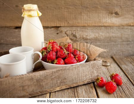 Fresh Strawberries And Milk In A Bottle