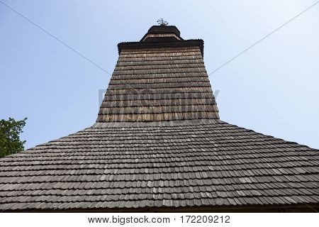 Dome of the ancient wooden Ukrainian church (XVIII century) from the Carpathians in the open-air Museum of Folk Architecture near Kyiv.