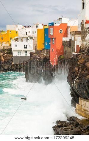 View of colourful houses of Punta Brava from beach in Puerto de la Cruz Tenerife Canary Islands Spain