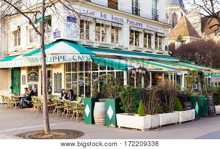 Paris France-February 152017: The cafe Louis Philippe situated in a busy but quaint southern corner of the Marais just at the end of Pont Louis Philippe is what is possibly the most adorable cafe in all of Paris.