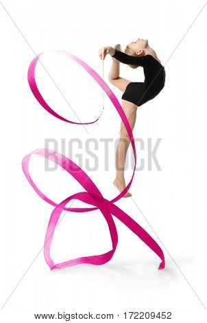 Young girl doing gymnastics with red ribbon, on white background