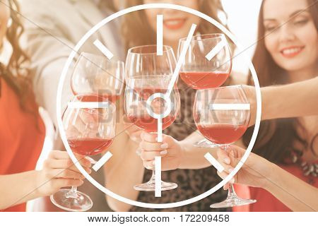 Time concept. People toasting with glasses of red wine