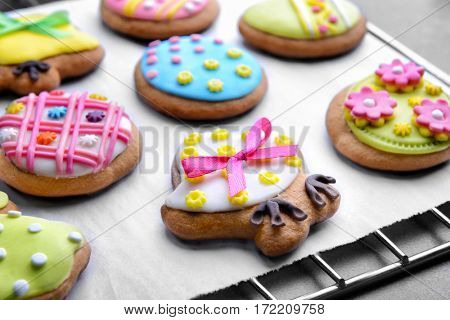 Baking grid with colourful Easter cookies, closeup