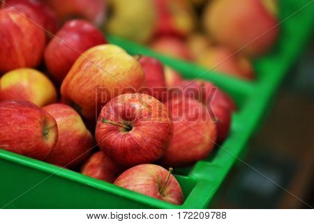Fresh fruit in plastic boxes on market
