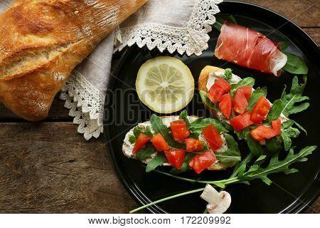 Delicious bruschetta on tray