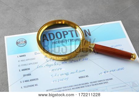 Magnifier and adoption form on table