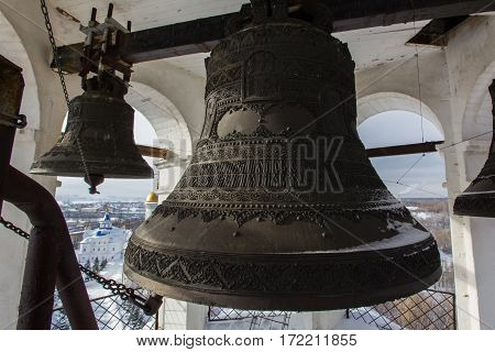 Kazan, Russia, 9 february 2017, Big iron bell in main tower of Zilant monastery - oldest orthodox building, close up