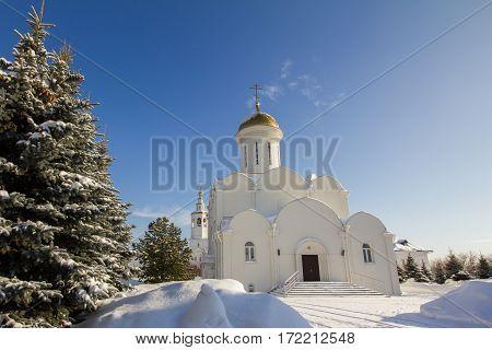 Kazan, Russia, 9 february 2017, Zilant monastery - oldest orthodox building - white church and blue winter sky, horizontal