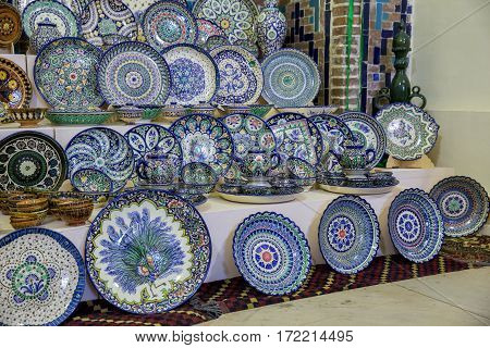 Sale of traditional Uzbek dishes in a souvenir shop at the Samarkand market