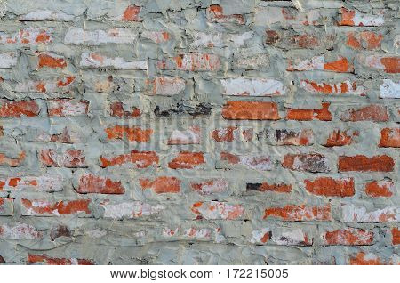 Texture of a rustic vintage old red brick wall