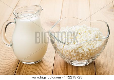 Transparent Jug Of Milk And Bowl With Cottage Cheese