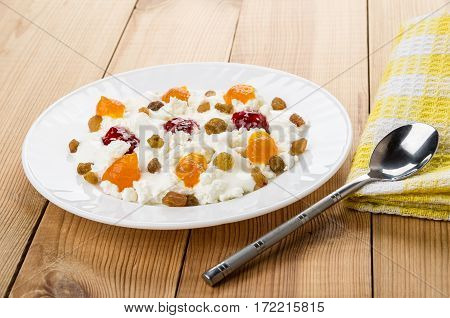 White Plate With Cottage Cheese, Yogurt, Raisins And Different Jams