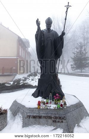 Mount St. Anna Poland - February 4 2016: Statue of Pope John Paul II in the winter fog in the Franciscan monastery on Mount St. Anna in Poland