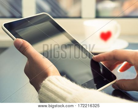 Women's Hands Are Holding The Tablet Against The Window