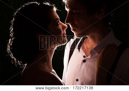 Married Couple In Dark Backlit
