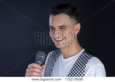 Male Black-haired Singer Performs Singing To Microphone