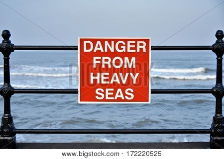 Danger from heavy seas sign on the beach at the English east coast.