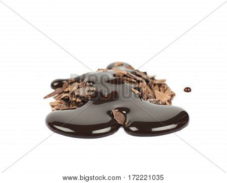 Pile of chocolate flakes with the liquid choco syrup spilled over it, composition isolated on the white background