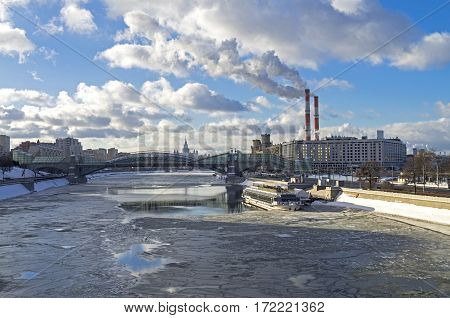 MOSCOW RUSSIA - JANUARY 21 2017: View of the Moscow River from the Borodinsky Bridge. Sunny day in January.