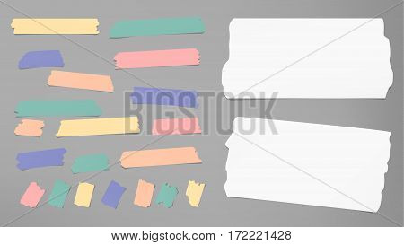 Ripped white notebook, copybook, note paper strips, colorful sticky, adhesive masking tape stuck on gray background.