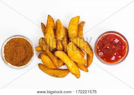 Fast food, potato slices on white background. Studio Photo