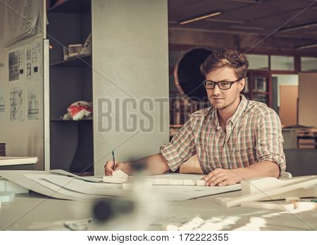 Young architect working in architect studio