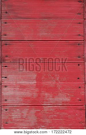 background consisting of red worn planks and nails