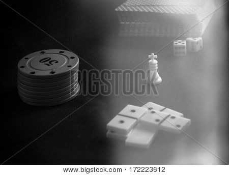items for board games playing dice and dominoes many people like to play board games is a good hobby and Have a good time
