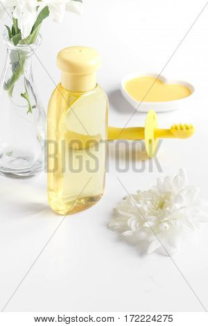 natural organic cosmetics for baby with herb on white background close up
