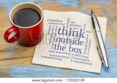 Think outside the box word cloud - handwriting on a napkin with a cup of coffee