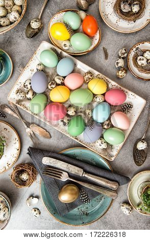 Colored Easter eggs. Festive table decoration with quail eggs