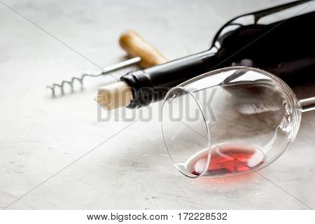 restaurant set with red wine bottle, glass and fresh grape on white stone table background