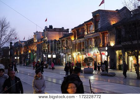 BEIJING - FEBRUARY 22: Qianmen street, a famous old shopping street over hundreds years in Beijing, China, February 22, 2016.