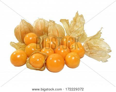 Pile of vivid yellow ripe Cape gooseberries with calyx isolated on white background