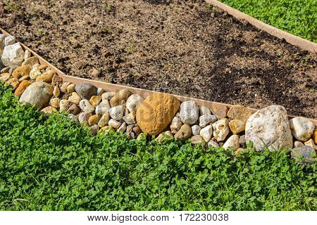 Empty Flower Bed Propped With Stones