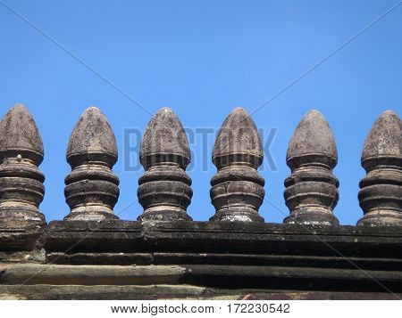 Roof details of Ancient Khmer Temple against vibrant blue sky, Phanom Rung Historical Park, Thailand