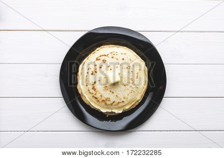 Pancakes With Butter In  Platter On White Background. Top View