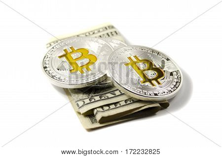 Shiny Silver And Gold Bitcoin Coins And Us Dollars On White Background