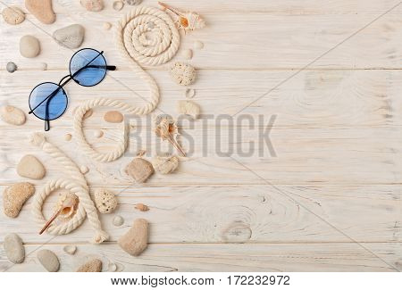 Sunglasses on bright wooden background. Selective focus.
